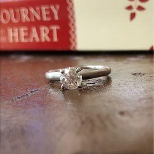 Jewelry - Genuine 0.6 carat diamond and platinum solitaire